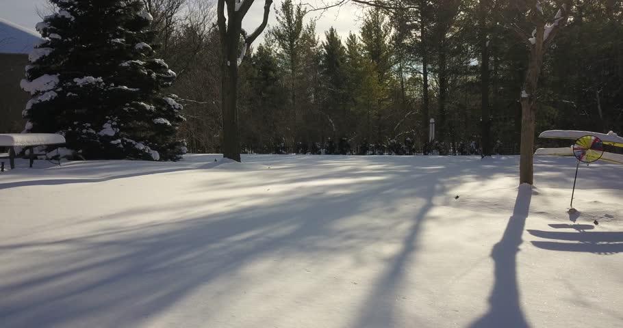 Very low altitude drone flight in pristine snow covered suburban backyard | Shutterstock HD Video #34295302