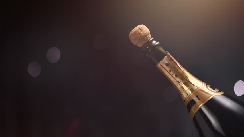 Champagne explosion. Champagne popping, opening champagne bottle closeup. Sparkling Wine over Holiday Bokeh Blinking dark Background. Party, Success, holiday celebrating. Slow motion UHD 4K