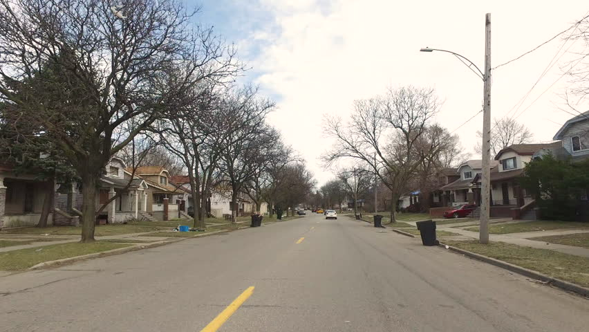 DJI OSMO POV driving through Detroit Neighborhood on the East Side Spring time. Shot could be used to show Detroit Neighborhoods, Burned out homes, Ghetto, East Side, POV, Arson, Motown, Hood