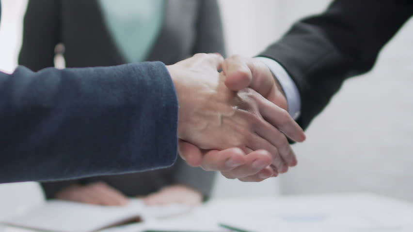 Male and female partners shaking hands, come to agreement, diplomatic relations | Shutterstock HD Video #34343686