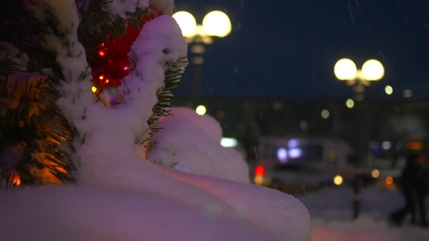 Christmas tree with luminous ornaments. Christmas tree in the park in the snow | Shutterstock HD Video #34343740