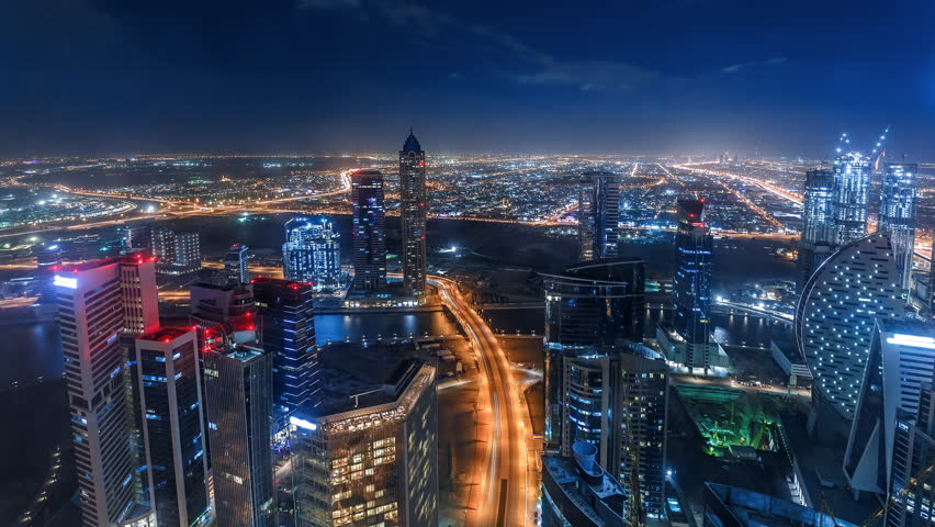 Nighttime skyline of a big modern city. Scenic aerial view of downtown Dubai, UAE with skyscrapers and highways. 4K time lapse.  | Shutterstock HD Video #34351414