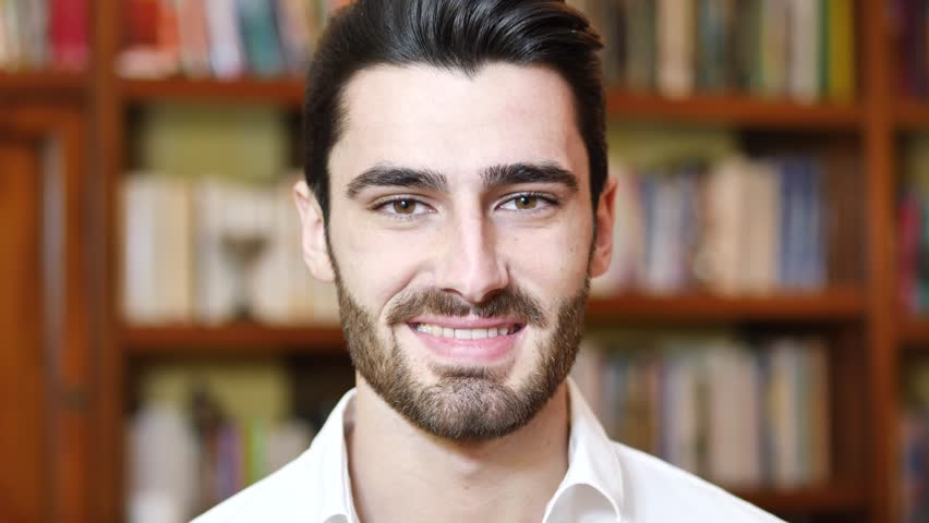 Headshot of handsome young man at home, looking at camera and smiling | Shutterstock HD Video #34354840