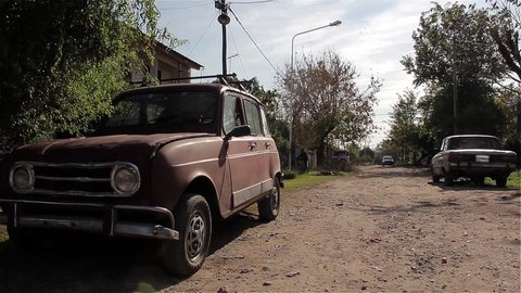 Old Renault 4 on a Poor Street in the province of Buenos Aires during the Coronavirus Pandemic in Argentina.