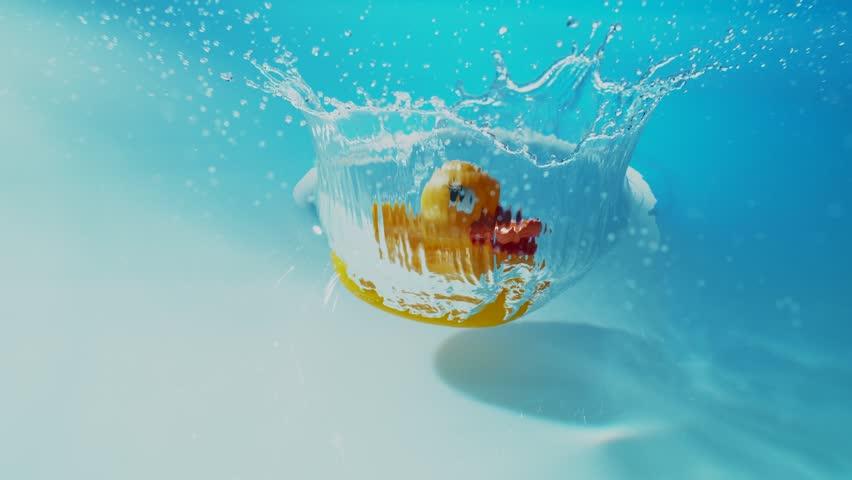 Rubber Duck hits Water Surface in Slow Motion.  Phantom Flex - 4K - 1000fps