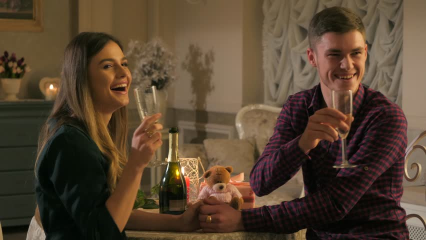 Young couple on a date in a restaurant, drinking champagne. | Shutterstock HD Video #34382410