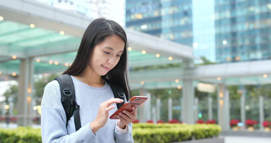 Asian Woman use of mobile phone in city   Shutterstock HD Video #34396219