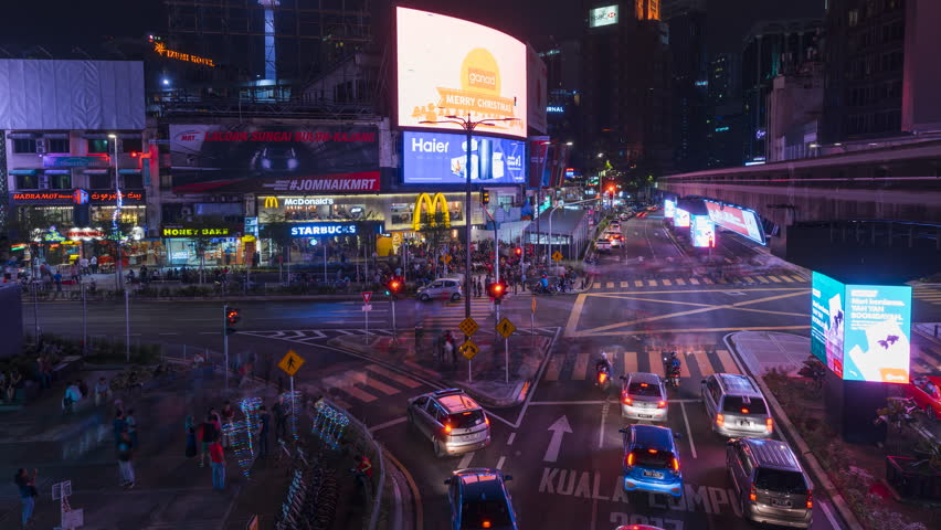 KUALA LUMPUR, MALAYSIA, DECEMBER 02 2017 : 4k ProRes time lapse on zoom in motion of transportation rush at night through the Bukit Bintang intersection in the Kuala Lumpur City Centre. | Shutterstock HD Video #34396399