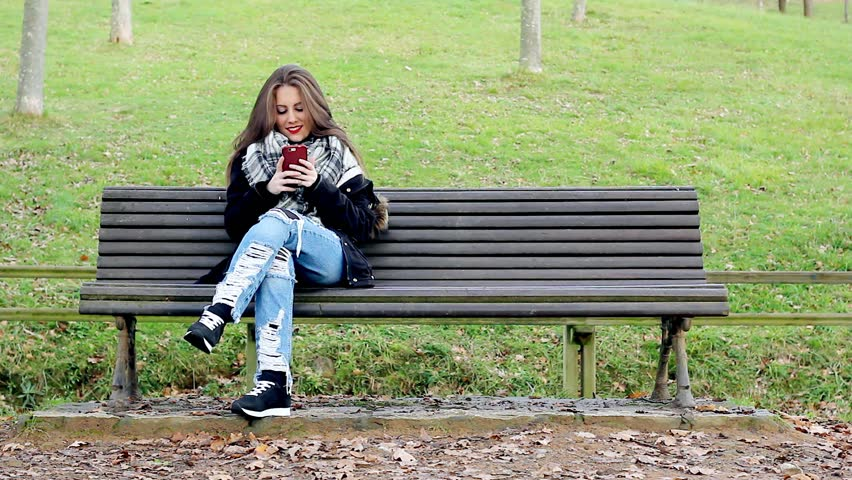 Lonely Mature Woman Sitting On A Park Bench