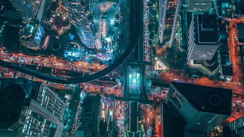 Time lapse,Hyperlapse ,Of traffic on city streets at night. Aerial view and top view of traffic on freeway, 4K.