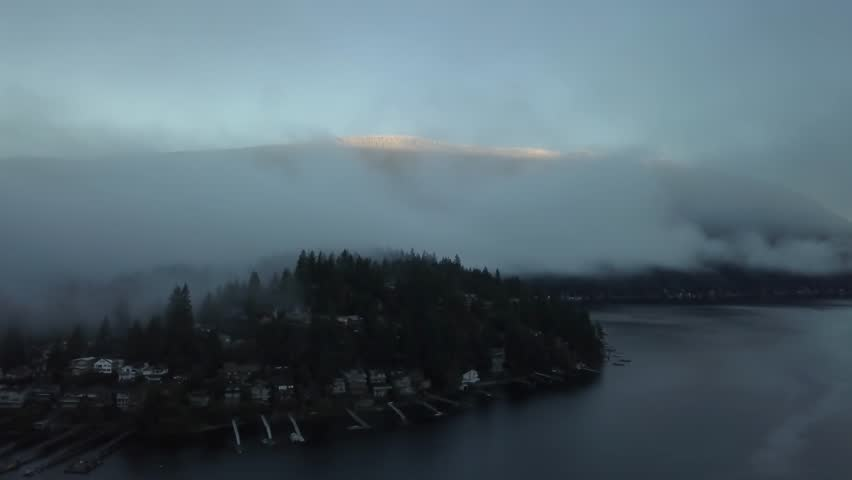 Aerial view on the luxury homes with a water view on Deep Cove during a cloudy and foggy early morning. Taken in North Vancouver, British Columbia, Canada. | Shutterstock HD Video #34423303