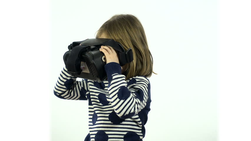 Studio, white background. Child, 4-5 years, wearing virtual reality goggles.
