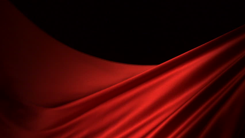 Red silk fabric flying in the air shooting with a high speed camera.