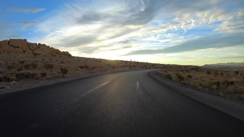 Red Rock Canyon scenic loop road rear view sunrise driving in the Mojave desert near Las Vegas, Nevada.   | Shutterstock HD Video #34427041