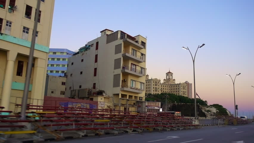 HAVANA, CUBA - AUGUST 14, 2017: Tracking shots from a car driving along the Malecon in Havana.  The Malecon is Havana's world famous waterfront. It is home to many crumbling apartments & buildings. | Shutterstock HD Video #34427377