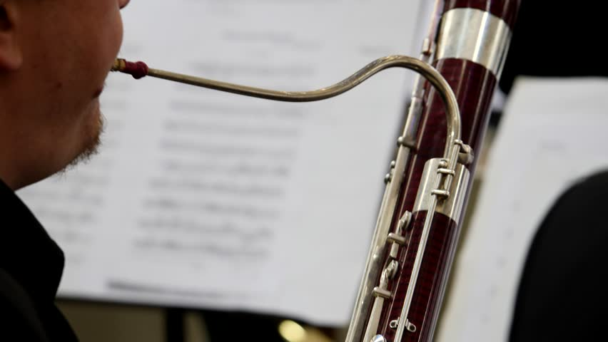 Footage of a musician playing on his bassoon...