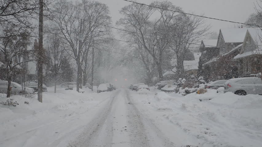 Slow motion snow falling on suburban street. Winter in Toronto, Canada.  #34442332