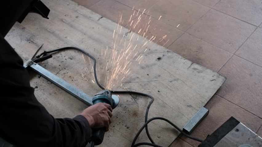Top view of worker welding iron on wooden board | Shutterstock HD Video #34475737