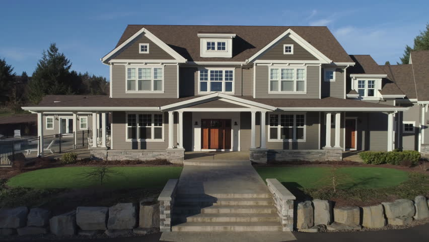 Beautiful new custom home, camera pulls out from front door to reveal house. Royalty-Free Stock Footage #34486822