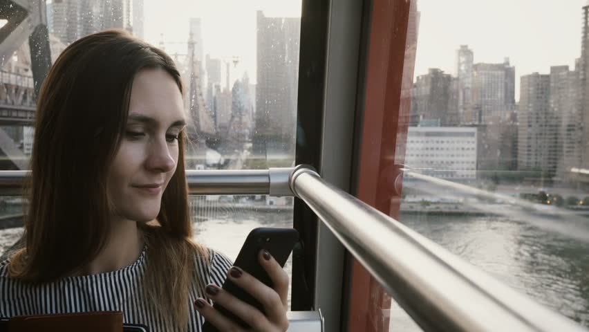 4K Business woman typing in air funicular cabin.  | Shutterstock HD Video #34490734
