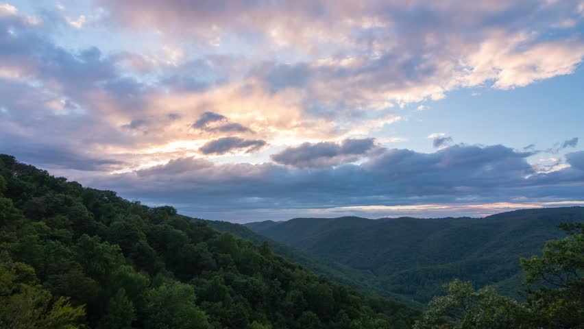 Sunset clouds over the green forest in Virginia, USA. | Shutterstock HD Video #34499359