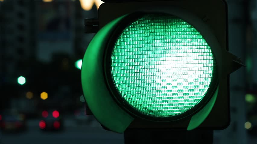 Green Traffic Light at Night. Close-Up.