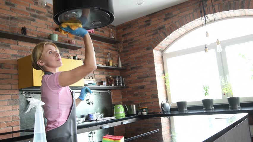Cleaning service. woman clean cooker at kitchen   Shutterstock HD Video #34545190