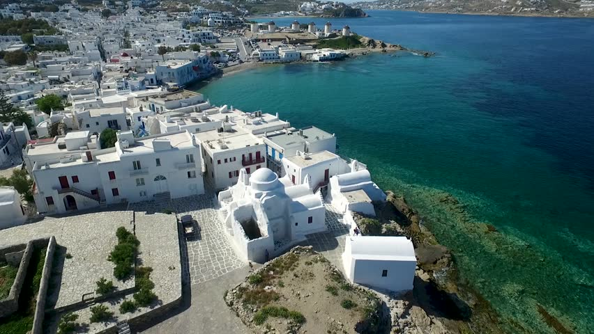 Fly over Panagia Paraportani Church at Kastro area, in the town of Mykonos, between Little Venice and the old port to the windmills, Mykonos on Cyclades, Greece   Shutterstock HD Video #34557343