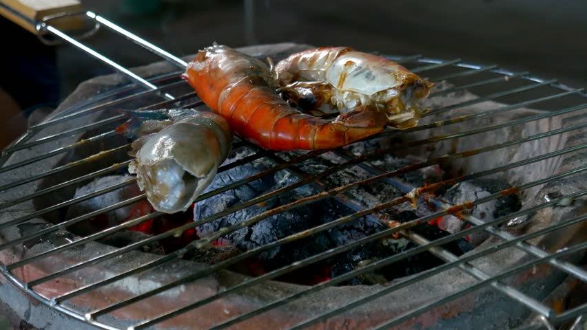 Grilled prawns on stove.   Shutterstock HD Video #34570918