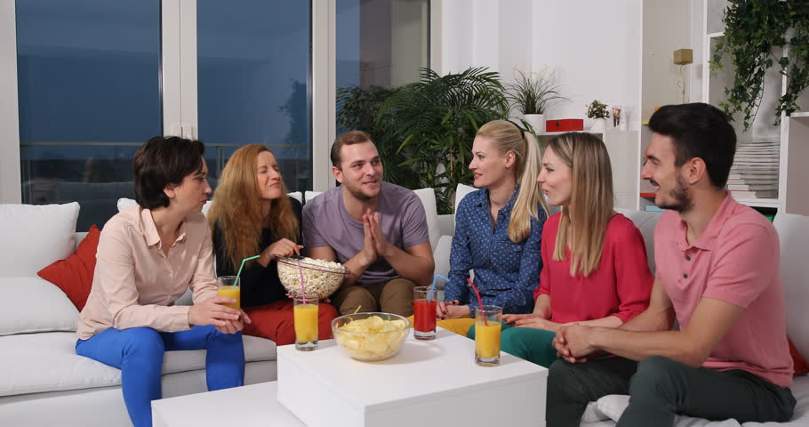 Happy Friends Cheerful Talk Sitting on Sofa Lifestyle Activity Party Living Room   Shutterstock HD Video #34574212