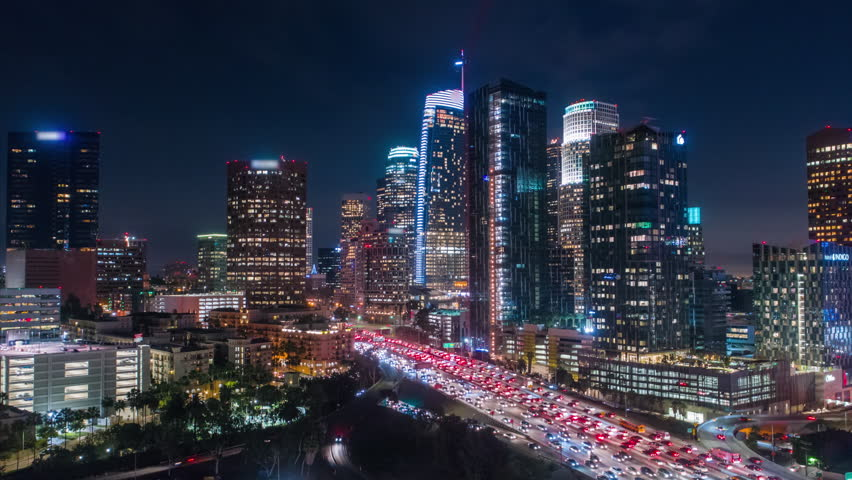 Cinematic urban aerial time lapse of downtown Los Angeles freeway with traffic