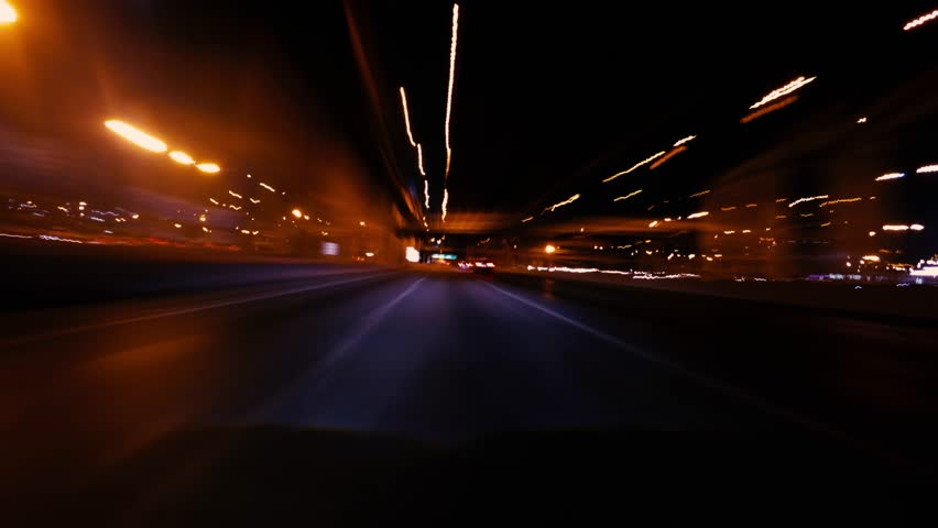 4K Timelapse - Long exposure shot of car moving on urban road at night. (POV #6) | Shutterstock HD Video #34615420