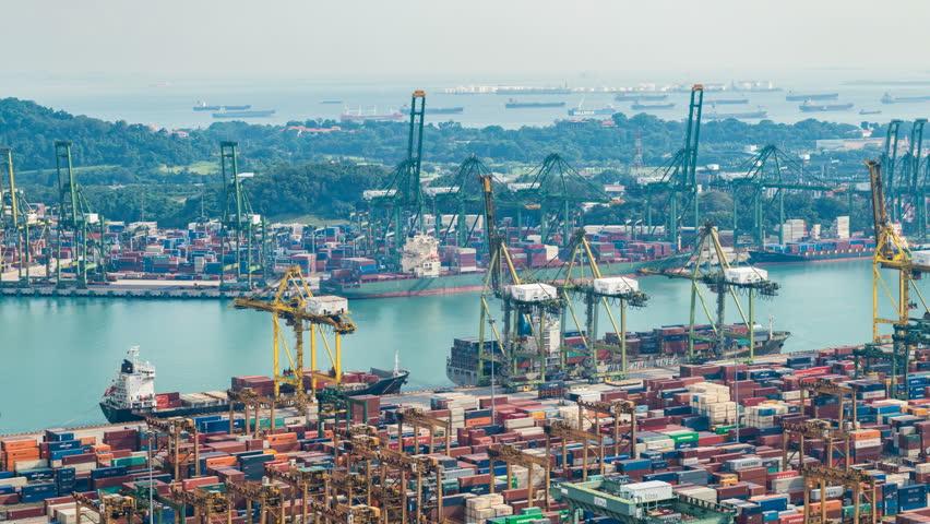 Singapore port, Singapore, April 21 2017 : 4K time-lapse : working crane loading bridge in shipyard