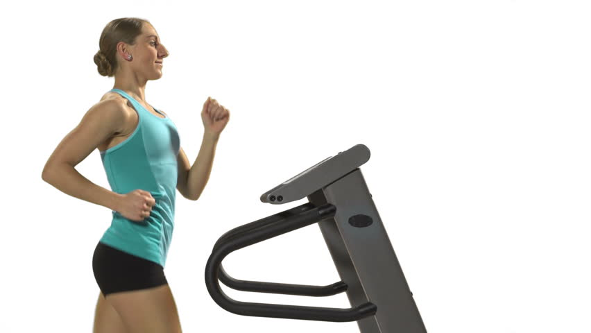Young woman on the Treadmill in front of white screen, close up   Shutterstock HD Video #3463127