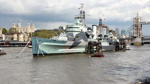 London, England - famous historic ship, HMS Belfast. Light cruiser navy vessel moored in Thames River.