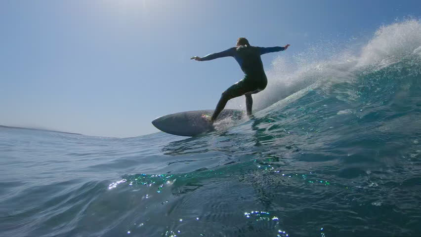 SLOW MOTION, LOW ANGLE, UNDERWATER: Surfer makes a turn on big blue ocean wave on hot sunny day in summer. Surfer carving awesome wave on his cool surfboard. Epic shot of male riding wave on surfboard   Shutterstock HD Video #34638991