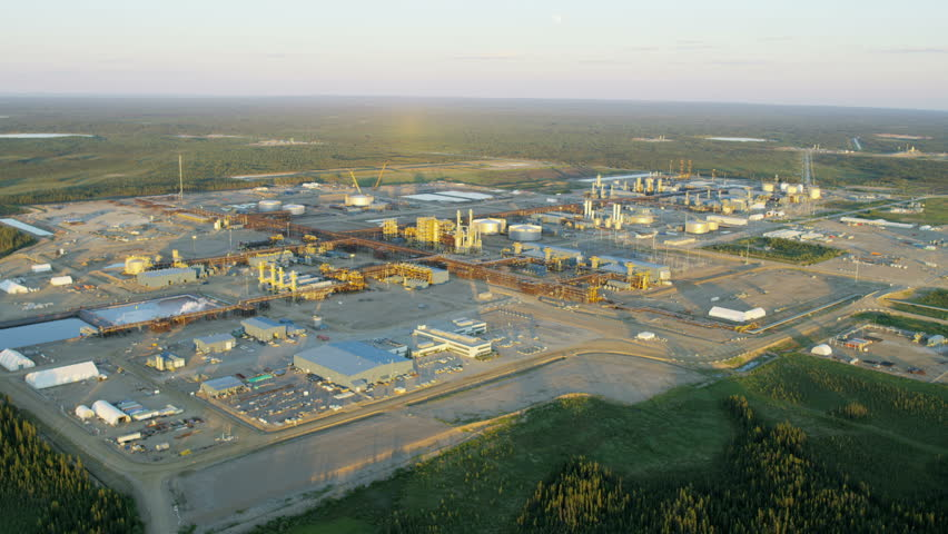 Aerial sunset view of an Oil Refinery industrial site within Athabasca oil sands near Fort McMurray Northeast Alberta Canada RED WEAPON