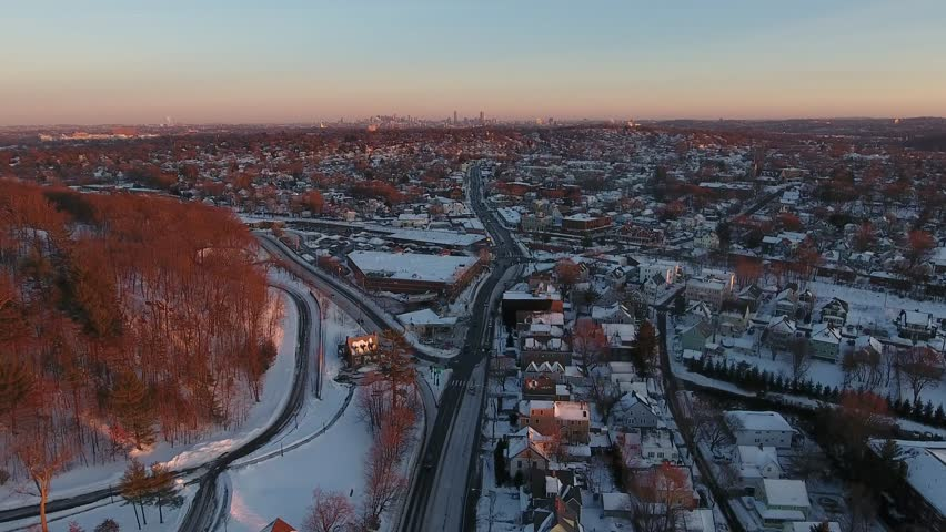 Aerial shot of Winter Boston City buildings and red forest.