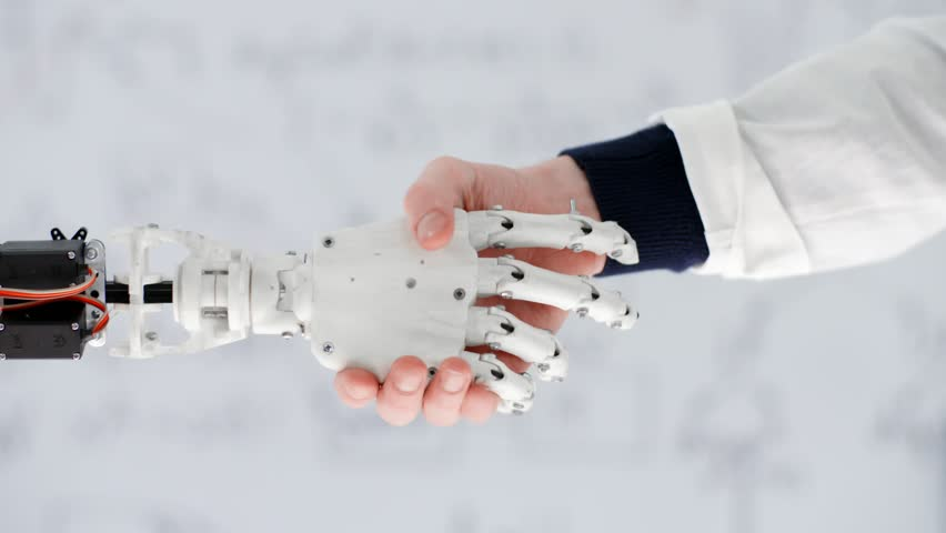 Male hand of scientist inventor shakes robotic arm on background white board with written formulas and equations in scientific laboratory