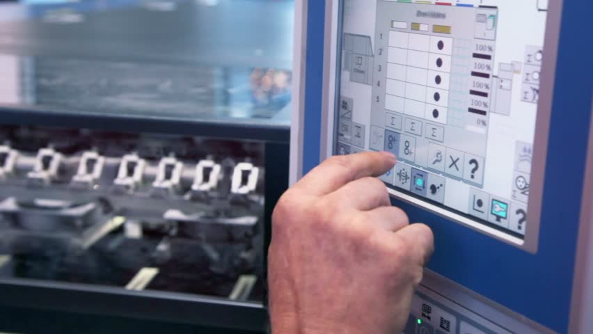 MOSCOW - OCT 8: Finger pushes buttons on control unit of printing conveyor during 23rd exhibition Polygraphinter at Crocus Expo, Oct 8, 2011, Moscow, Russia. Total exhibition area reached 25000 sq. m. | Shutterstock HD Video #3468194