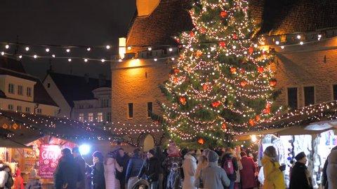 Tallinn, Estonia-December 25,2017: Holiday Fair With Christmas Tree Illuminated