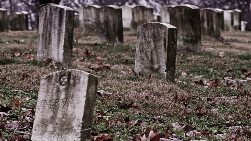 Old, weathered gravestones at a cemetery (Dolly Move) (Multi-Clip Series)