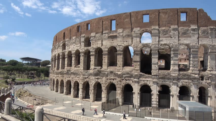Footage of Colosseum or Coliseum also known as the Flavian Amphitheatre in Italian Anfiteatro Flavio or Colosseo is an oval amphitheatre in the centre of the city of Rome Italy beautiful summer day 4k