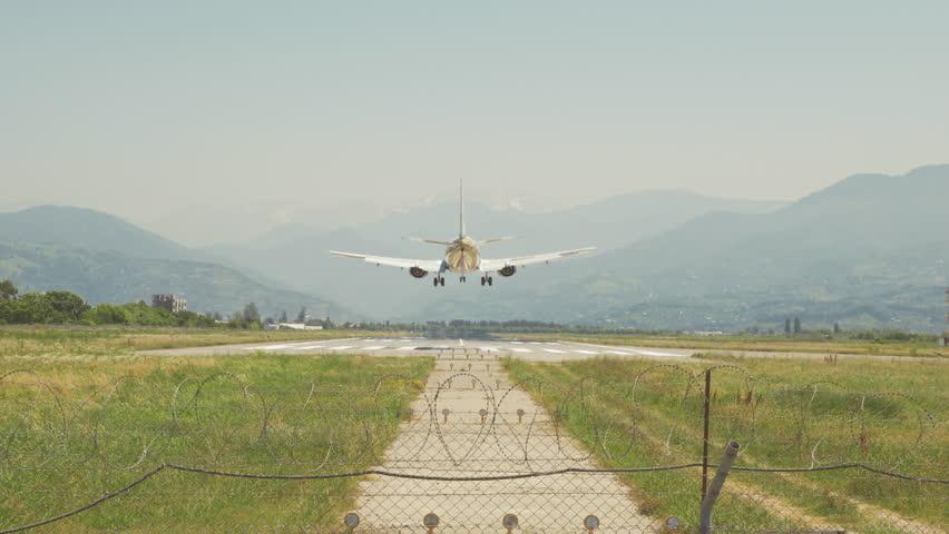 Airplane landing in the mountains of Batumi city, Georgia