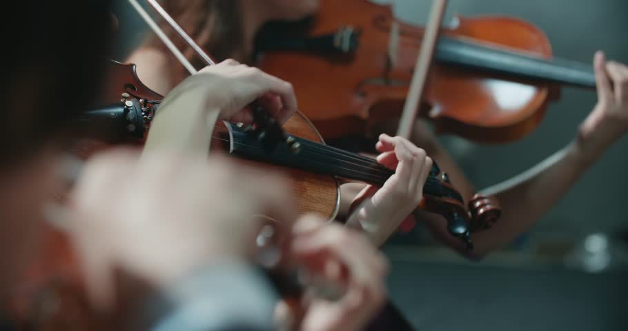 String quartet performs on stage, close-up of violin in work | Shutterstock HD Video #34735450