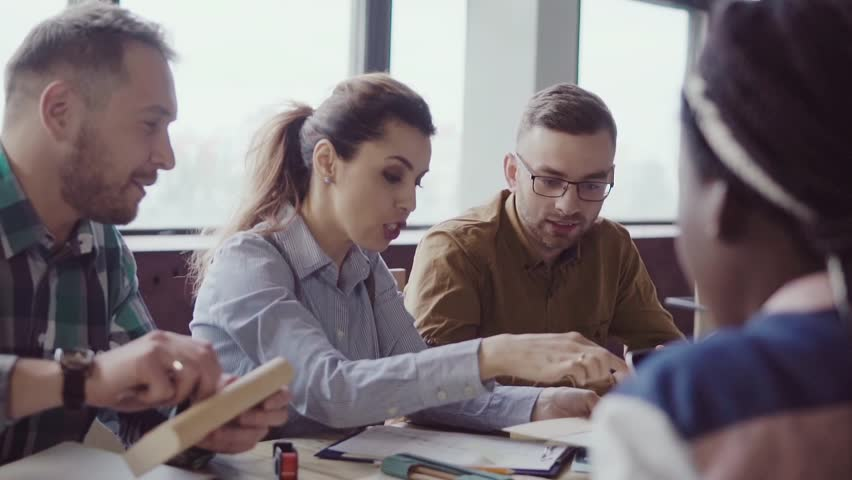 Creative business team meeting in modern office. Mixed race group of young people choose the color and material. | Shutterstock HD Video #34735735