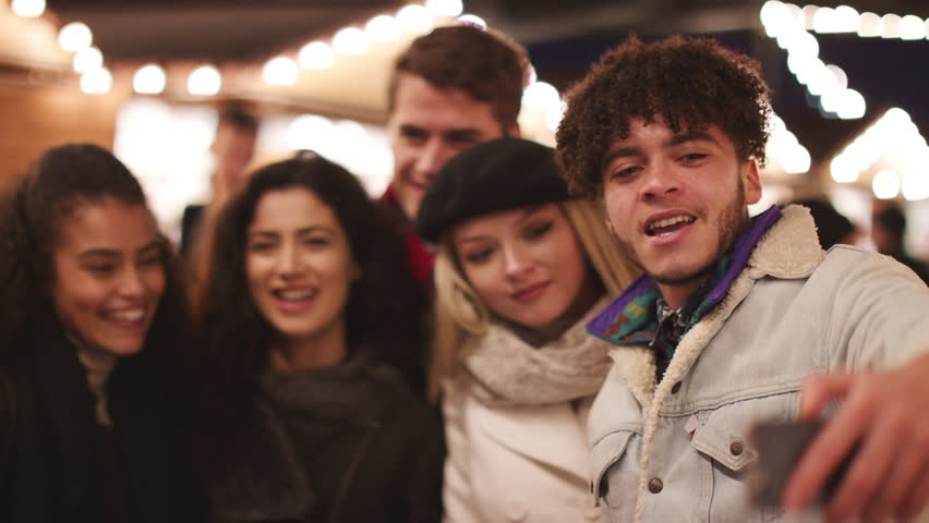 Young Friends Posing For Selfie At Christmas Market | Shutterstock HD Video #34741762