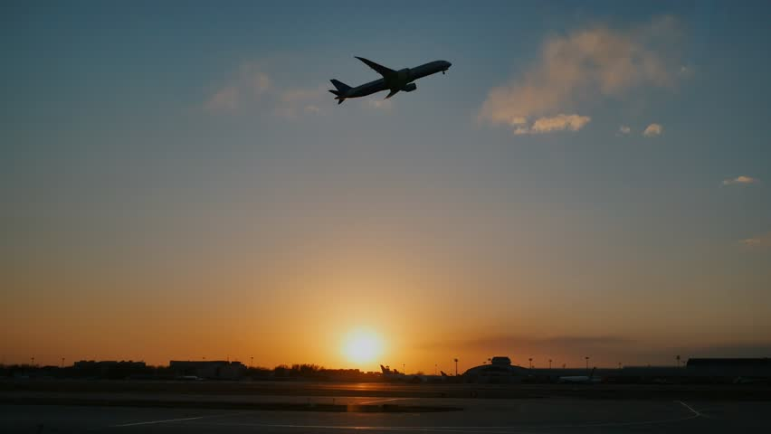 Plane taking off sky sunset sun dusk in airport China. Beijing.