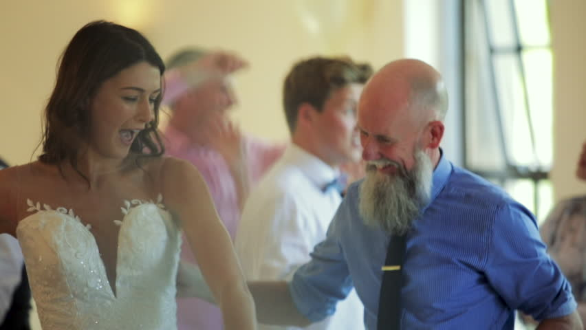 Father and bride dancing together on her wedding day with all of the other guests. #34757794
