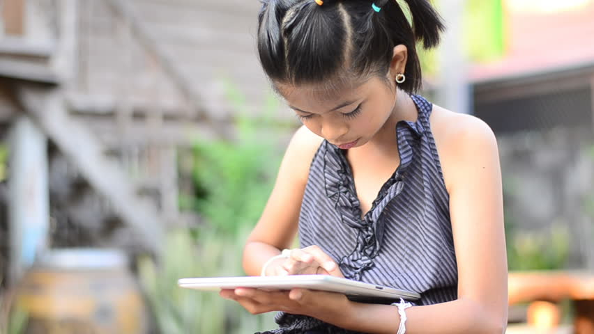 Asian young girl using computer tablet    Shutterstock HD Video #3477536